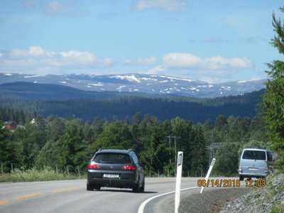 Distance view along highway - snow still in mountains