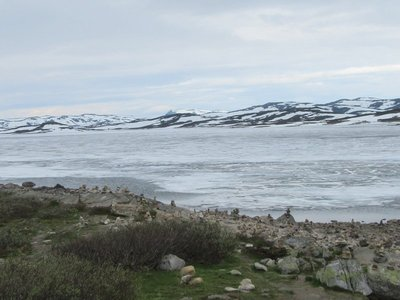 Frozen lake known as Halnefjorden and rocky shore