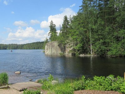 View of rocks and trees and lake at Verla, Finland