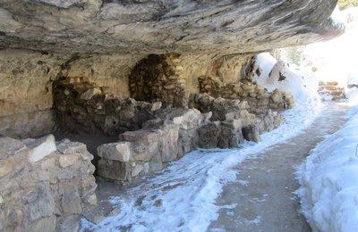 Homes built under rock overhangs