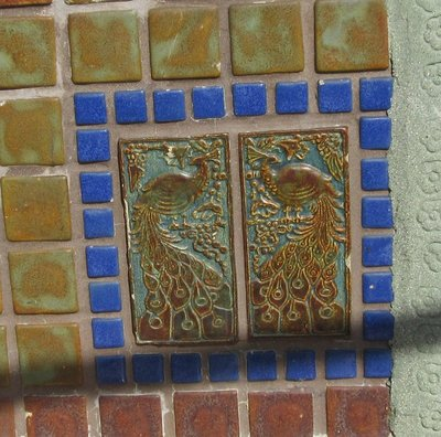 Peacock tiles in wall
