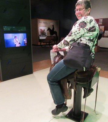 Reta rides into a cowboy scene