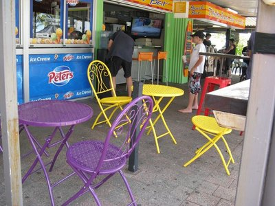 Colourful seating by ice cream shop