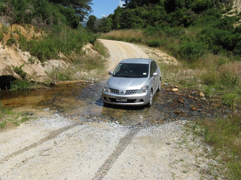 Fording the water on road to Awaroa Bay