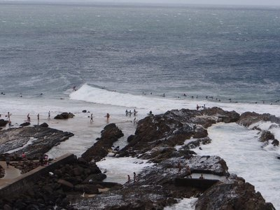 Surfers waiting in line for their turns
