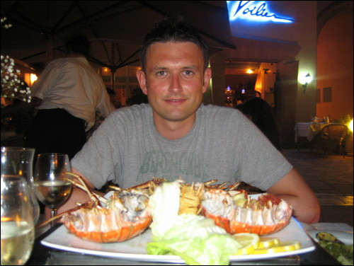 eating lobster on the beach