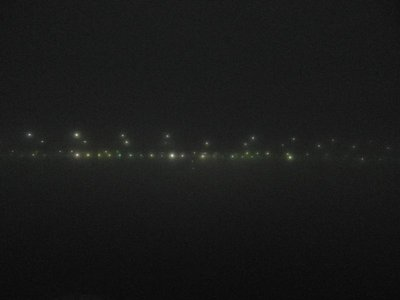 QM2 passing under Verazanno-Narrows Bridge in thick fog