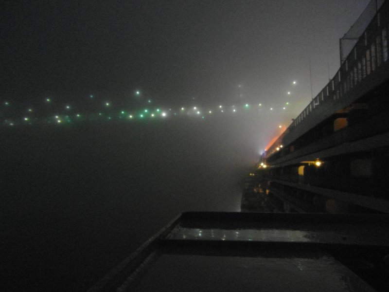 QM2 passing under Verazanno-Narrows Bridge in thick fog 2