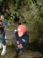 About to abseil 100 metres down into a canyon (scared, thus smiling through gritted teeth!)