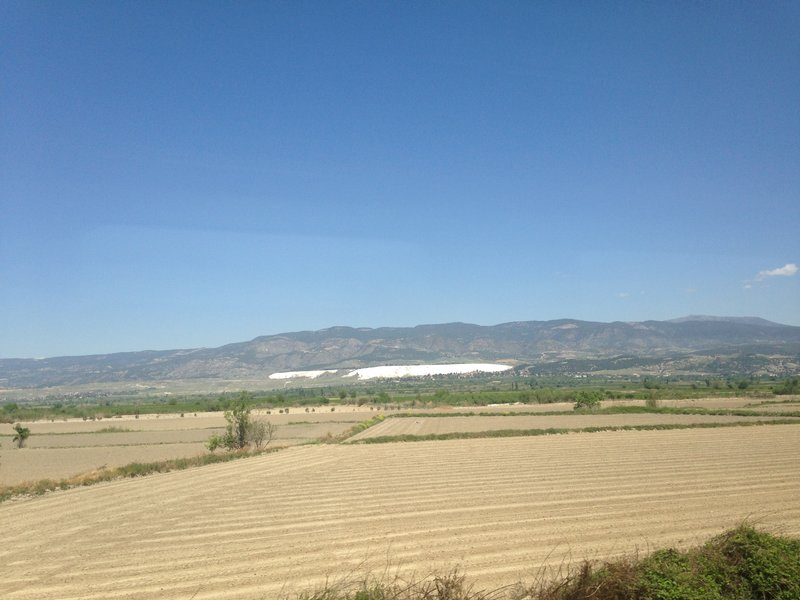 On the train to Pamukkale (Denizli) - the white limestone terraces at Pamukkale in the distance