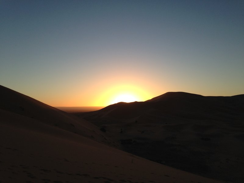 The sun coming up in the Sahara!
