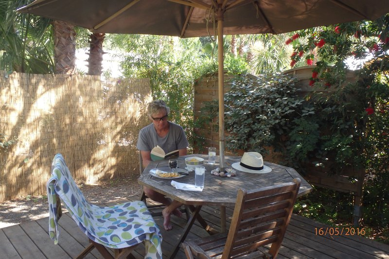 Reading on the deck of our cabin in Hyères - waiting for the car to be fixed!!