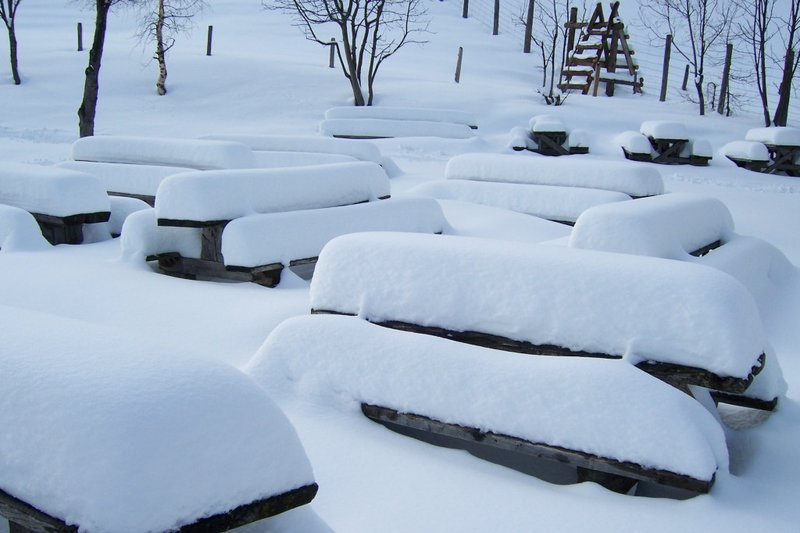 Snowy seats and tables