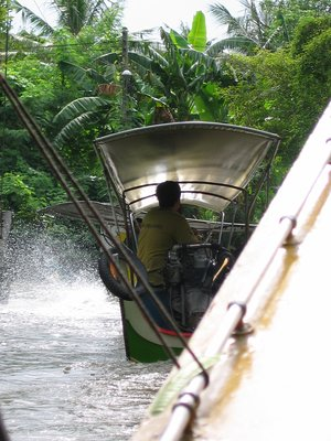 into a boat, on our way to Damnoensaduak Floating Market