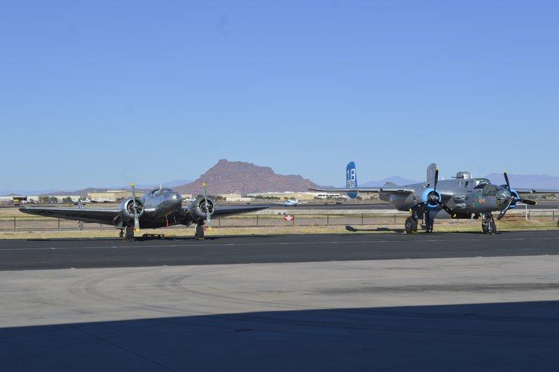 Planes on Tarmac beside the runway