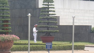 Outside the Mausoleum, there were Soldiers guarding Ho Chi Minh.