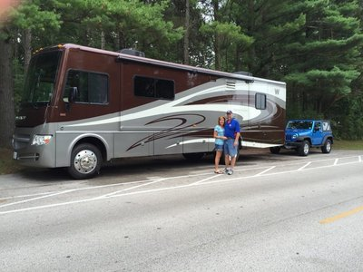 Mike and Maureen with their rig: 2014 Winnebago Sightseer 33C and 2010 Jeep Wrangler dinghy
