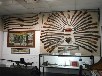 A replica of the hotel reception where the original guns were displayed