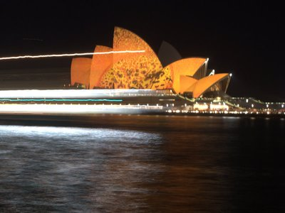 Opera House Sails Lit By Vivid Sydney & Ferry