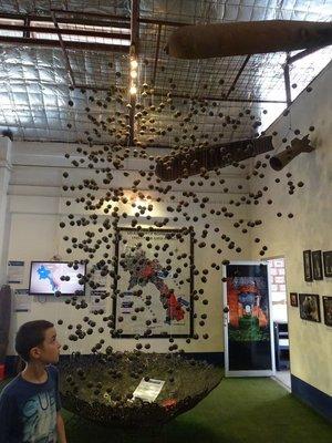 COPE Visitors Centre, exhibit of cluster bomb