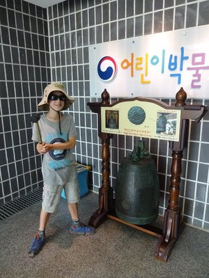 Striking a traditional Korean bell, Gyeongju National Museum