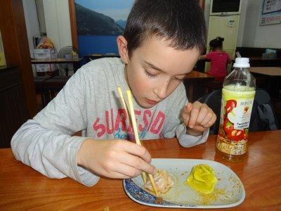 Thomas eating wontons
