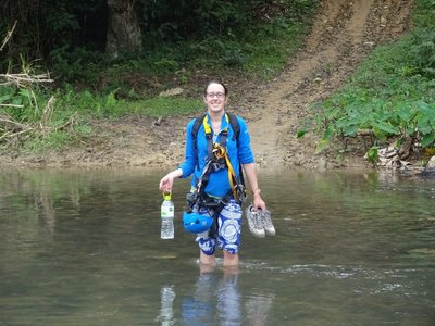 Wading through the river after trekking through the jungle back to civilisation