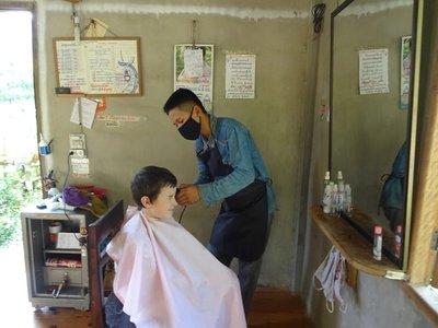 Thomas getting his hair cut for 10,000kip (1 pound)