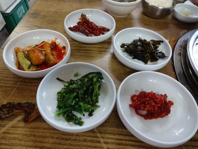 Side dishes accompanying our fish meal including kimchi