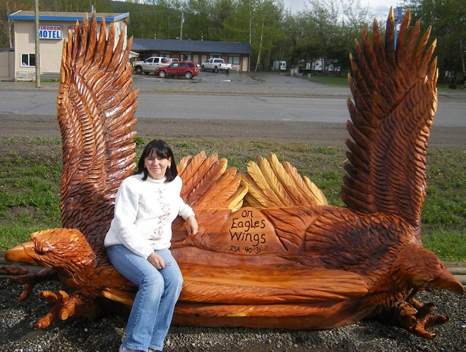 Woodcarved bench in Chetwynd BC