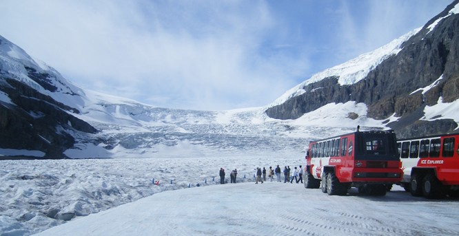 Athabasca Glacier with snow shuttles in foreground, Banff NP