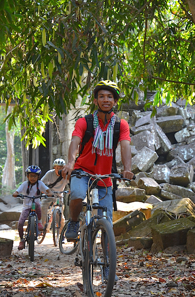Our young local guide called Young and us at the back of Pre Khan enjoying our quiet ride among the ruins