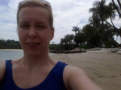 Squinting in the sun at Palawan beach