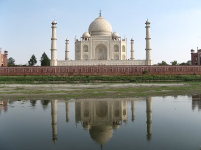The Taj Mahal reflected in the river Yamuna