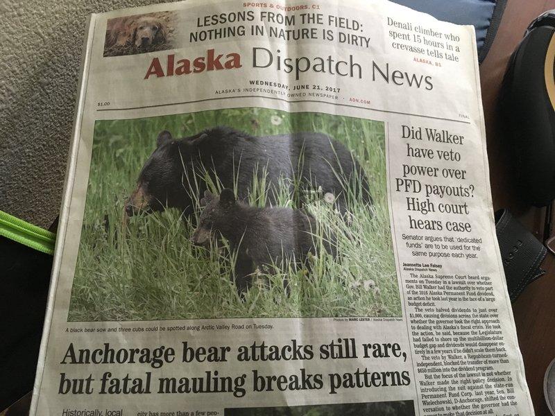 large_Newspaper_..ting_people.jpg