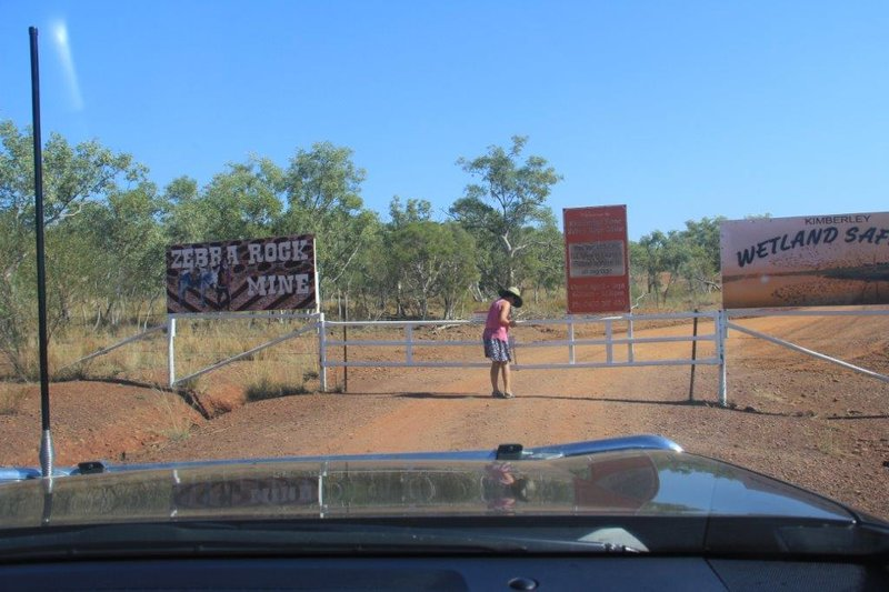 Opening gates to the mining area where we camped