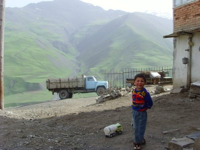Xinaliq - lorries in the village 2009