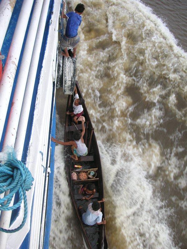 Kids climbing onto the boat