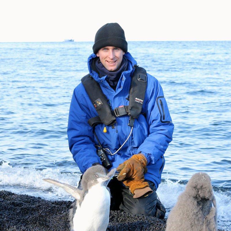 With Edelie penguin chicks in Antarctica