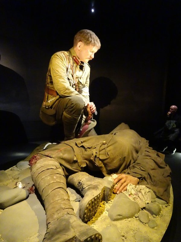 Another person featured is Lt. Colonel Percival Fenwick; he had been a surgeon in Whanganui and Christchurch, after emigrating to NZ from England. He was among the first group of NZeders to land on Gallipoli, on April 25th,1915. His despair is shown as he leans over a fatally wounded Canterbury infantryman, Jack Aiken.