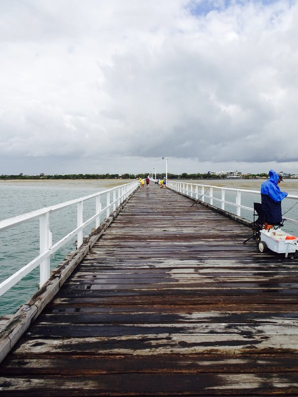 The Urangan Pier was built in 1913 to reach a deep water channel.  It was needed because of all the sand here. The pier was used to transfer coal, sugar, and timber between the rail and ships.