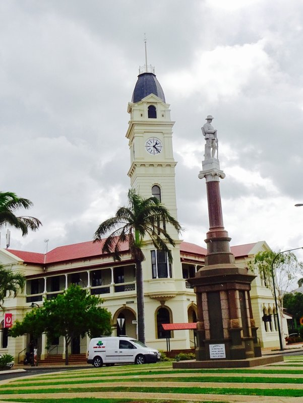 The Bundaberg War Memorial is located on a traffic island in the CBD. In the background is the post office and the clock tower.