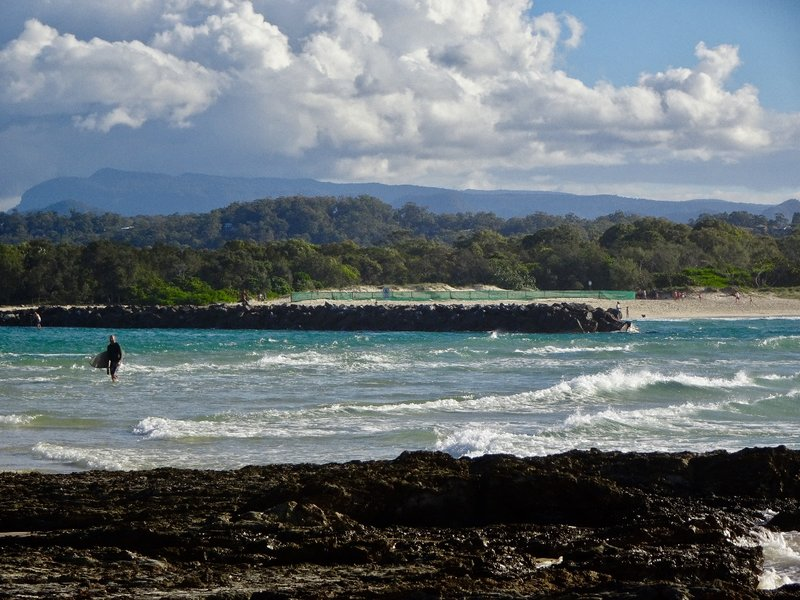 The Currumbin Alley is formed by the bar of the Currumbin Creek as it enters the ocean. The water is shallow, and the surfers can almost walk out to the waves.