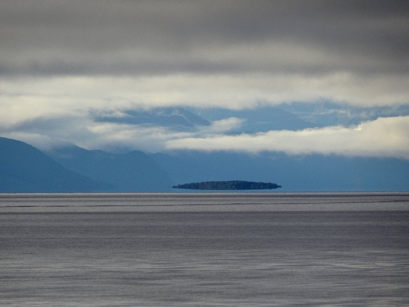 This is a picture of an island located in Lake Te Anau that was taken early evening.
