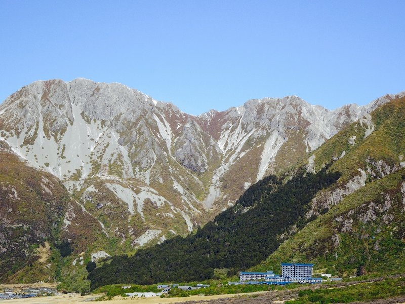 A long distance view of the Mt Cook Village; Mt Sebastopol is in the background.