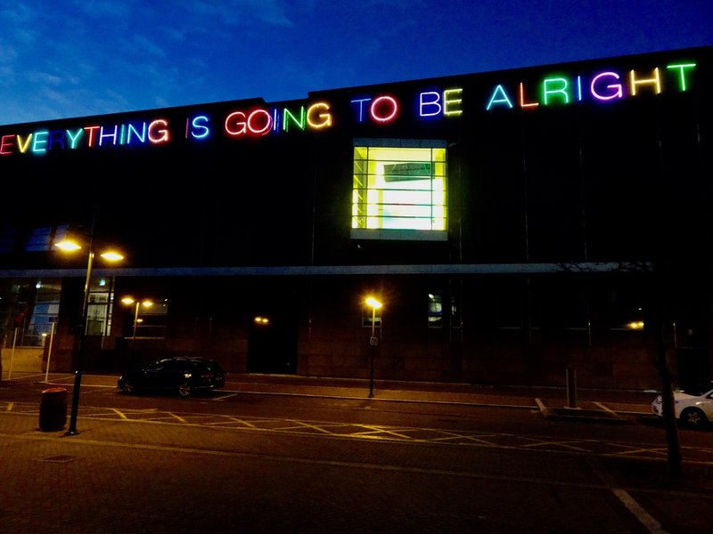 At night, this neon artwork lights up one side of the Christchurch Art Gallery.