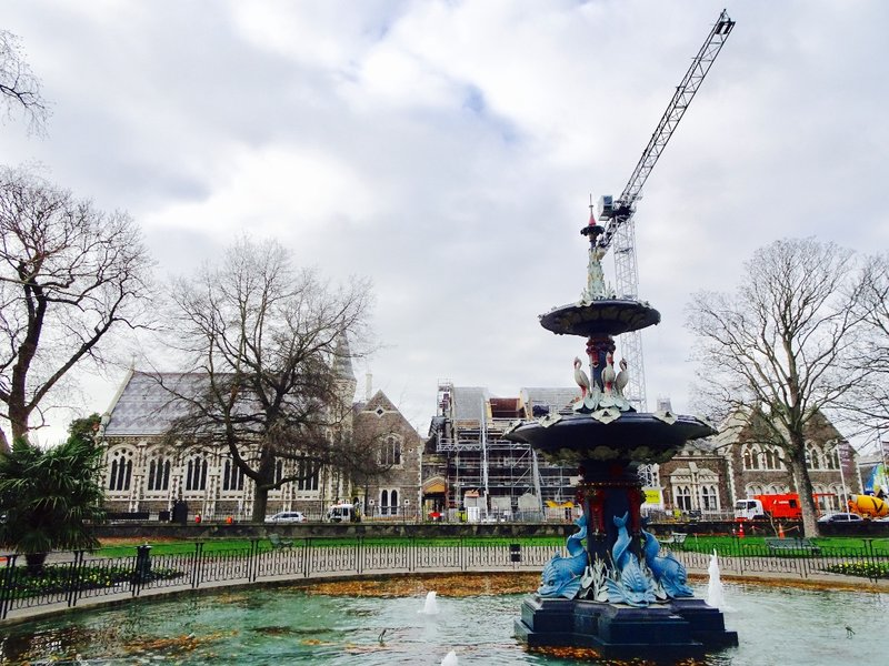 The Peacock Fountain is next to the Canterbury Museum and overlooks Hagley Park. However, this view of the fountain looks at the Christchurch Arts Center; it is actually 23 buildings (from the former University of Canterbury) that are being restored after the earthquakes.