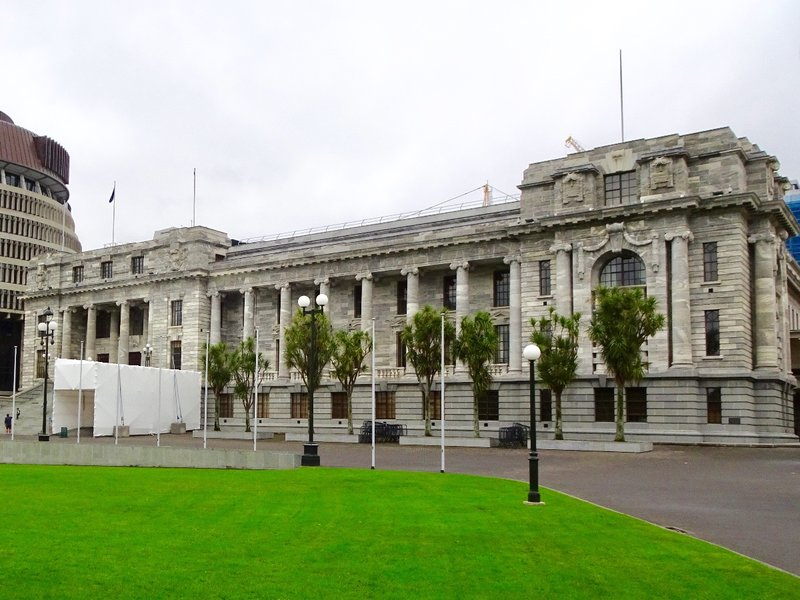 The Parliament House was meant to be built in two phases, but only the first was completed. It has the debate chambers for the House of Representatives, the Speaker's office, and the visitors center. NZ has no senators.
