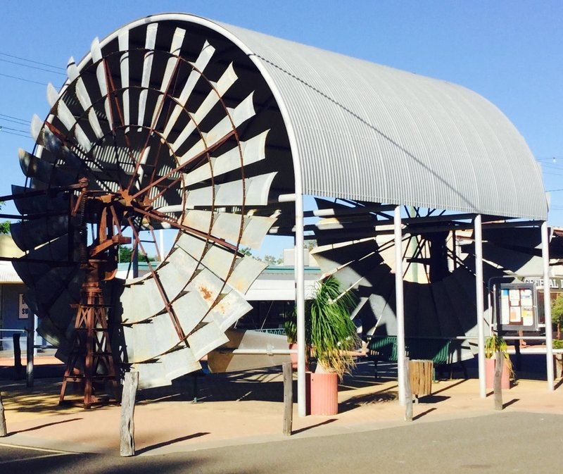 """These two Comet Windmills were donated to Hughenton for the """"Centenary of a Federation Celebration"""", in 2001. The windmills pumped water at the Bogunda Station for over 45 years. They are 20 ft in diameter."""