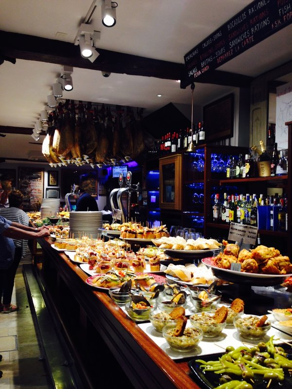 Dinner in San Sebastián. Spread out along the bar are little plates of delicious Tapas, they call them Pintxos in this region. You stack as many as you can onto a tray and pay per plate, very cheap and very delicious!